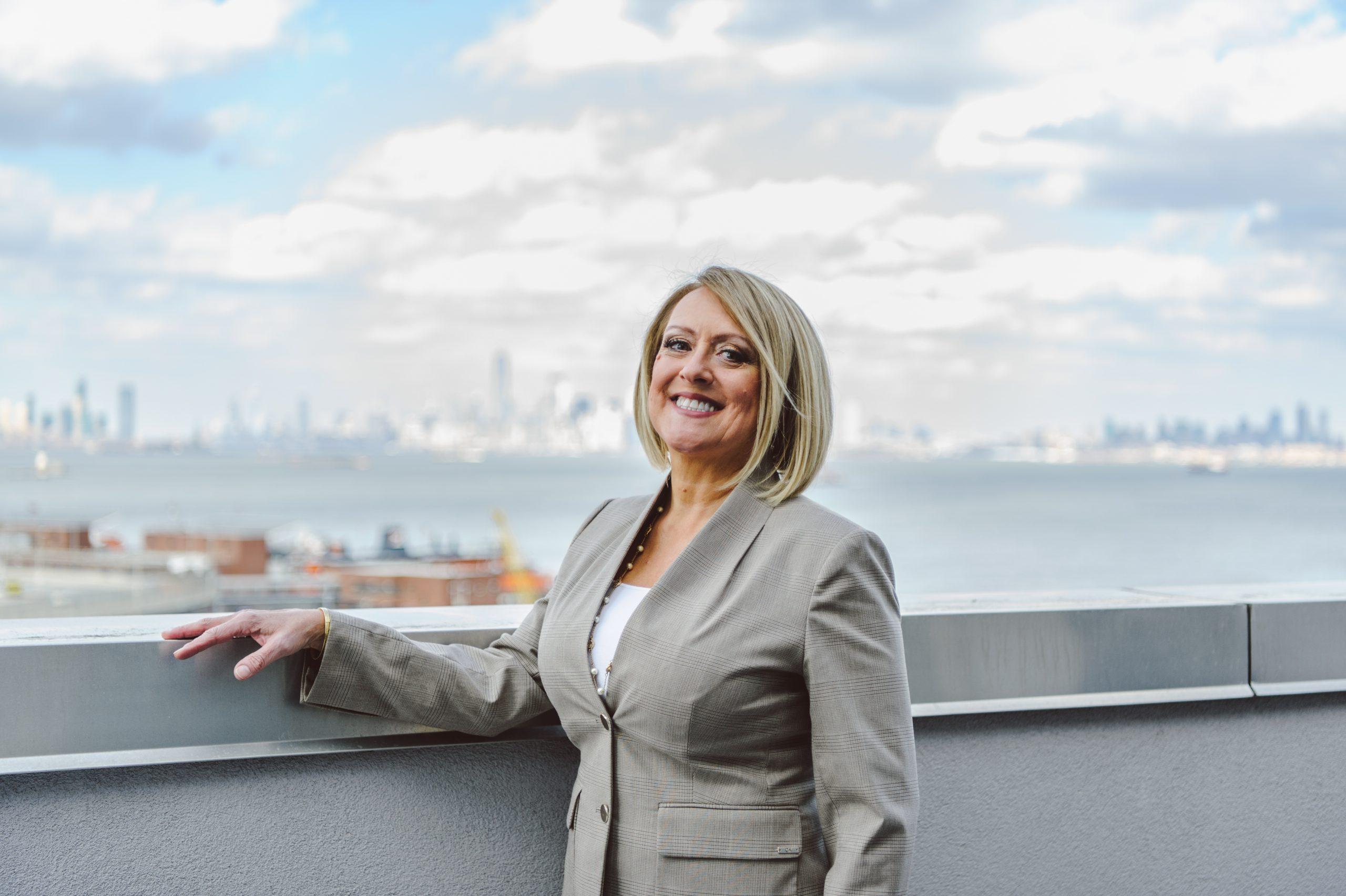 Holly Wiesner Olivieri overlooking Manhattan from St. George Staten Island