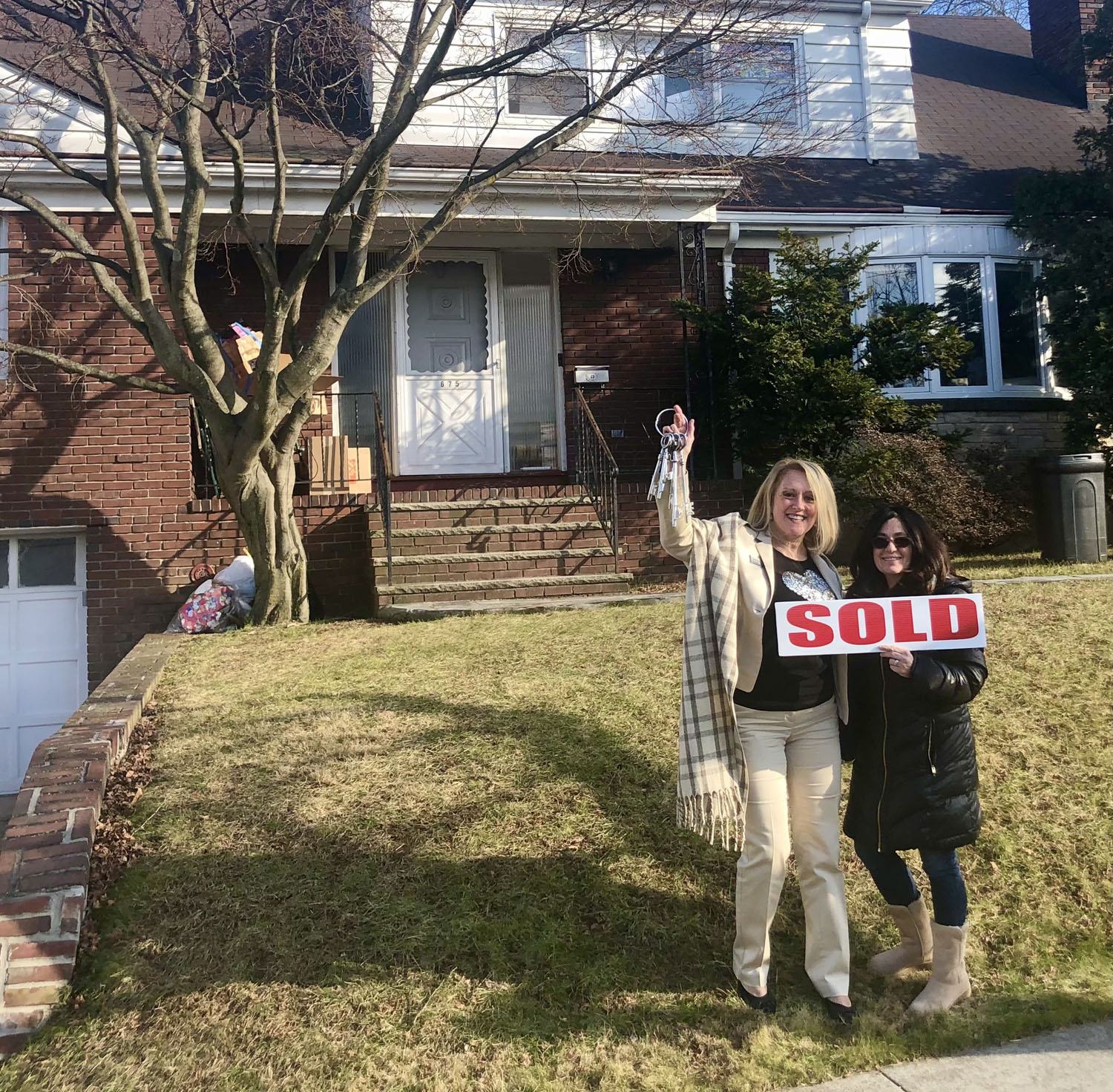 Holly Wiesner Olivieri with a happy new homeowner