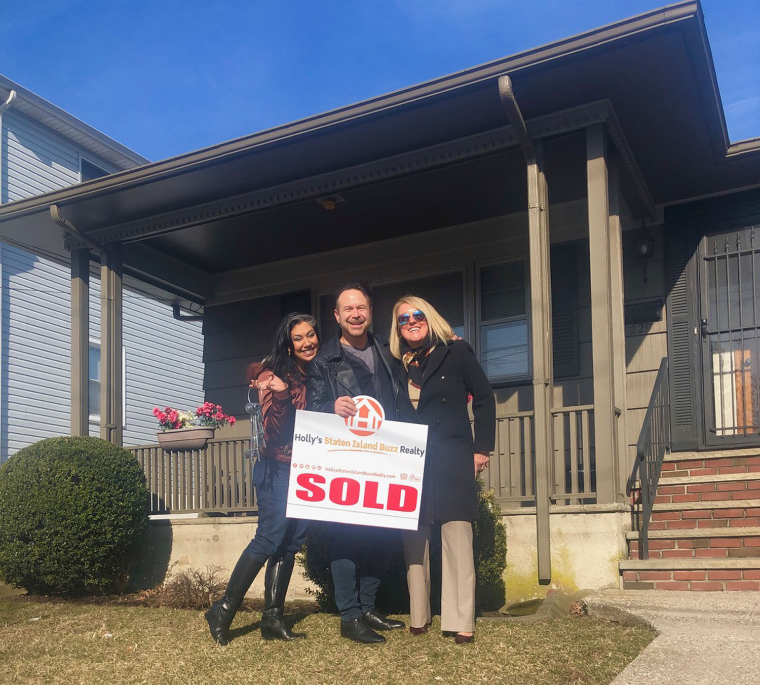 Happy Clients celebrate after using Holly's Staten Island Buzz Realty To Buy Their Staten Island Home